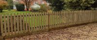 Palisade Fencing with Gravel Board