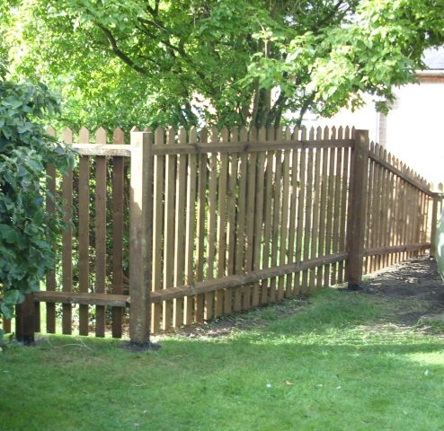 Taller Palisade fencing with a slope