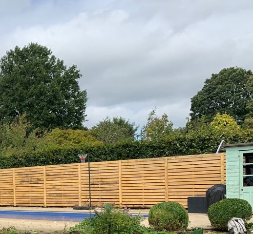 Horizontal oak fencing in a large garden