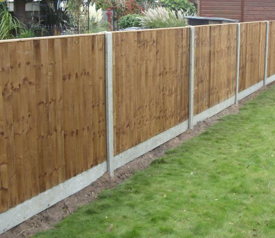 Closeboard panels with concrete posts and gravel boards