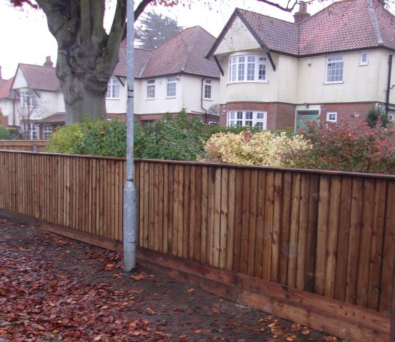 Brown Closeboard with double retainer gravel boards and capping