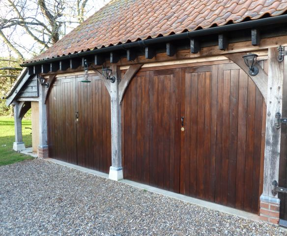 Larch garage doors in Sadolin Jacobean Walnut