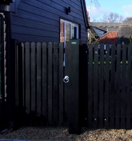 Helmingham Pedestrian gate with flat top & round pales in Black barn paint