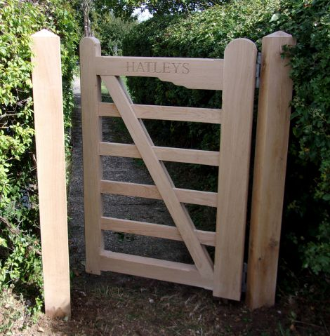 Melford hand gate in Oak with lettering