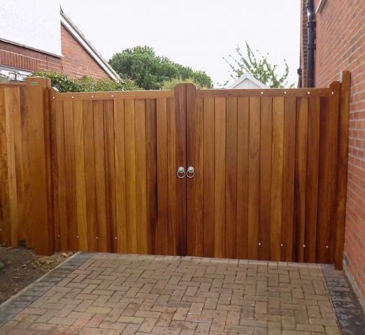 Blyth gates in Osmo oiled Iroko hardwood