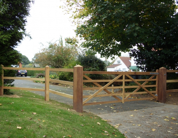 Kennett Gate in Iroko with matching post and 3 rail