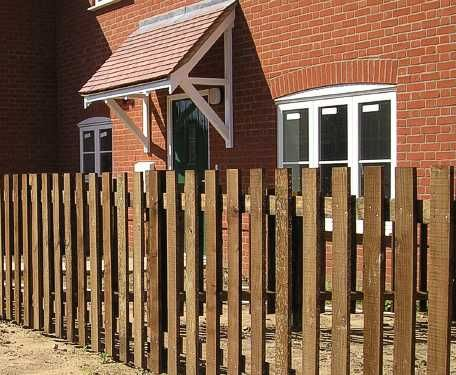 Flat top Palisade fencing in sawn timber