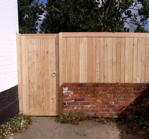 T & G Wall top fencing as a side panel to a Glemham gate all in Larch