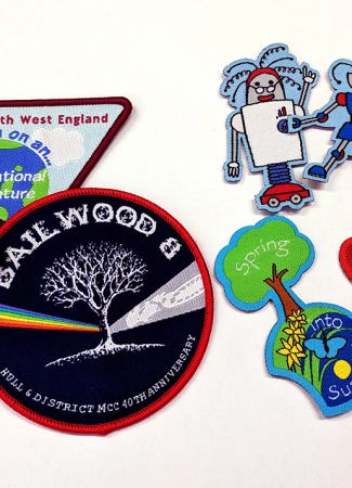 Woven Badges with overlocked or heat cut borders