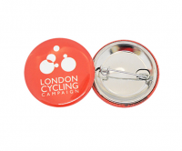 Colourful button badges with safety pin