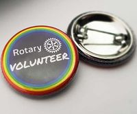 32mm diameter Rotary Volunteer badge with safety pin