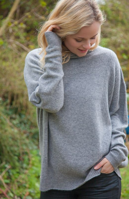 Grey cashmere oversized roll neck sweater with ribbed detail.