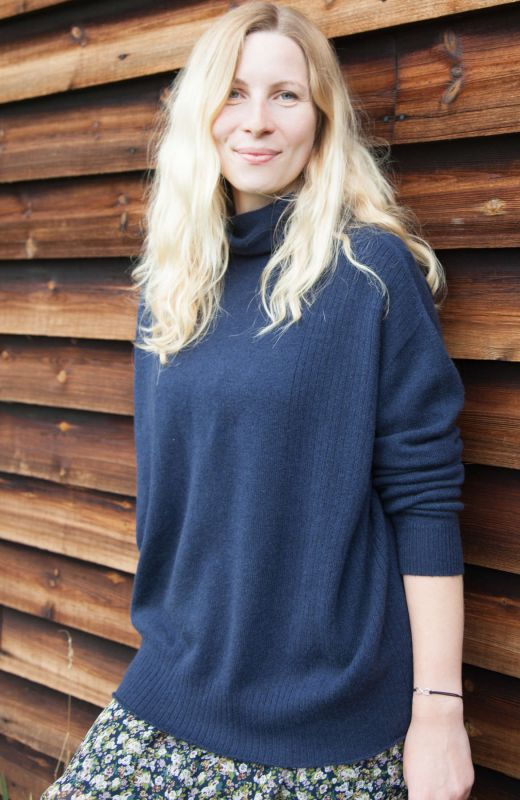 Navy cashmere oversized roll neck sweater with ribbed detail.