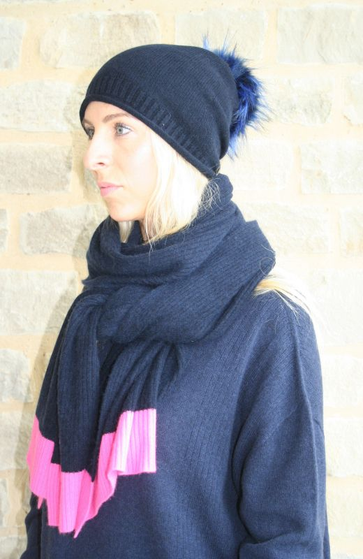 Roll edge rib detail beanie with faux fur detachable pom in navy.
