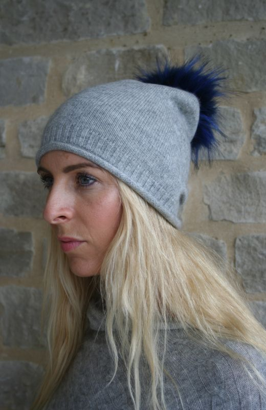 Roll edge rib detail  plain knit beanie with faux  fur detachable pom in grey.
