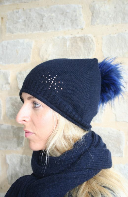 Roll edge rib detail  plain knit beanie with 4cm diamante starburst embellishment and detachable faux fur pom in navy.
