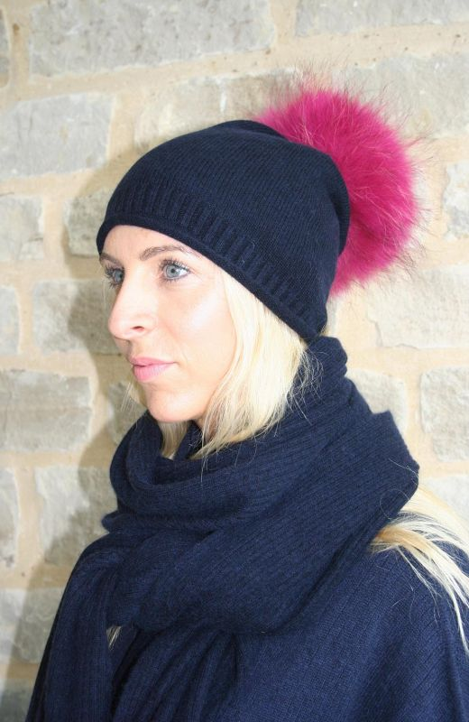 Roll edge rib detail beanie with real fur detachable pom in navy.