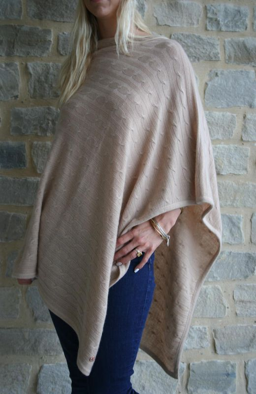 Cable knit design poncho in camel.