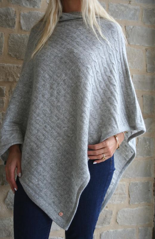 Cable knit Cashmere poncho in grey.