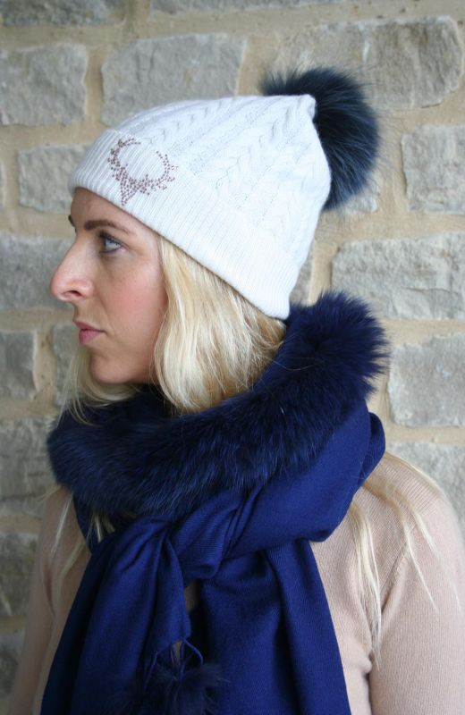 Cable beanie with 5cm diamante stag embellishment and detachable real fur pom in cream.
