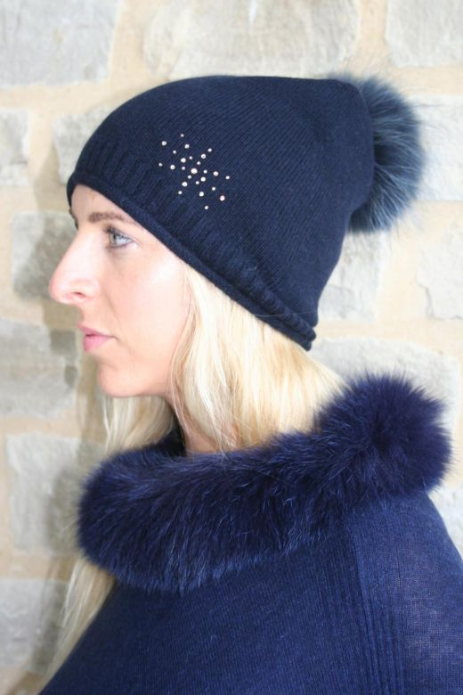 Cashmere beanies with fur poms