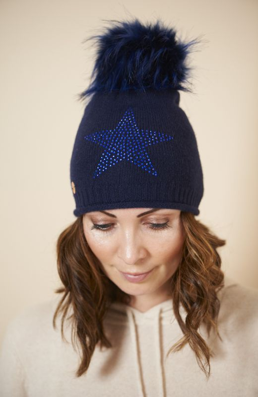 100% sustainable cashmere roll edge beanie with large diamanté star and faux fur pom